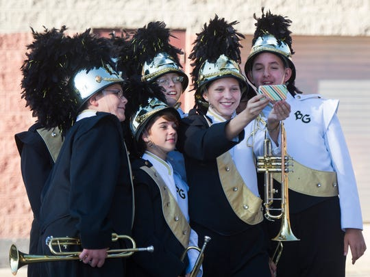Buffalo Gap marching band members take a selfie before their performance at the Blast in the Draft competition at Stuarts Draft High School on Saturday, Sept. 27, 2014.