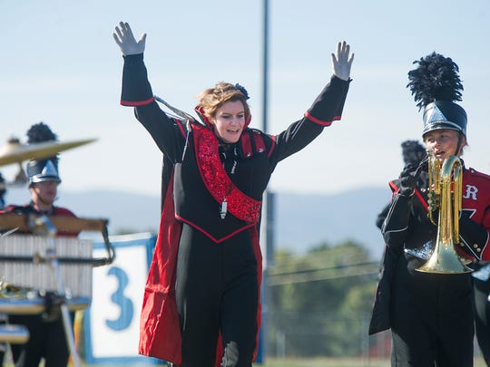 Riverheads' drum major, Caitlyn Wood, runs on the field during their performance at the Blast in the Draft marching band competition at Stuarts Draft High School on Saturday, Sept. 27, 2014.