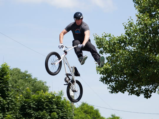 Scott Wirch flies through the air during a stunt show put on by King BMX at 2014 XtremeFest in Waynesboro.
