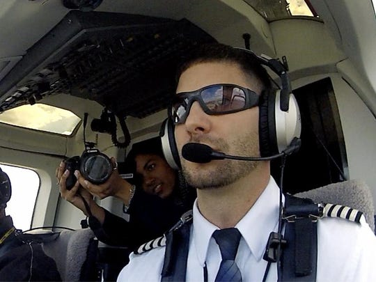 Jelan Coley films Justin Sasso flying helicopter over Jersey City still taken from mounted go-pro on dashboard.
