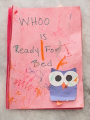 "The original ""Whoo is Ready for Bed?"" manuscript written by Teryn Tilque and her mother Judy Watermolen on pink construction paper last year. The Green Bay-area authors turned that draft into an interactive children's book that is selling online and in specialty stores in eight states."