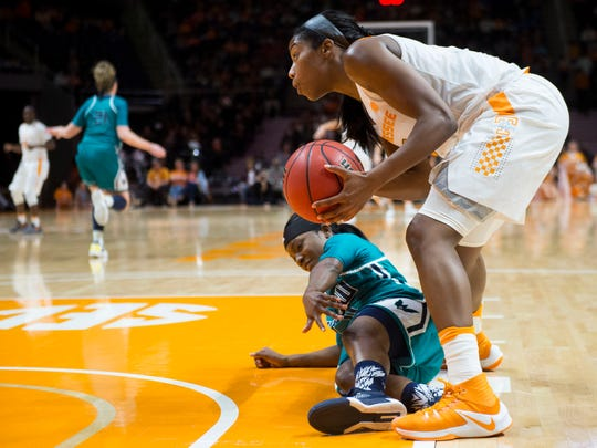 Tennessee's Jordan Reynolds steals the ball from UNC Wilmington's Jasmine Steeleon at Thompson-Boling Arena on Thursday, Dec. 29, 2016.
