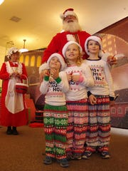 Santa and Mrs. Claus visit with children who rode on the Polar Express in Burlington. The Polar Express train ride was sponsored by the Vermont Children's Trust Foundation. More inside.