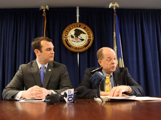 Assistant U.S. Attorney James McCall (left) and U.S. Attorney Charles Oberly answer questions at press conference about four men who have been arrested in connection with the theft of a $2 million ruby during a robbery at Stuart Kingston Jewelers in November 2011. The robbers escaped with $4.4 million in jewelry, including the 5-inch, 4-pound Liberty Bell Ruby, made from the largest mined ruby in the world.