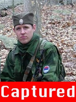 An undated handout picture released by the FBI in October 2014 shows alleged cop killer Eric Frein on the FBI Most Wanted list.