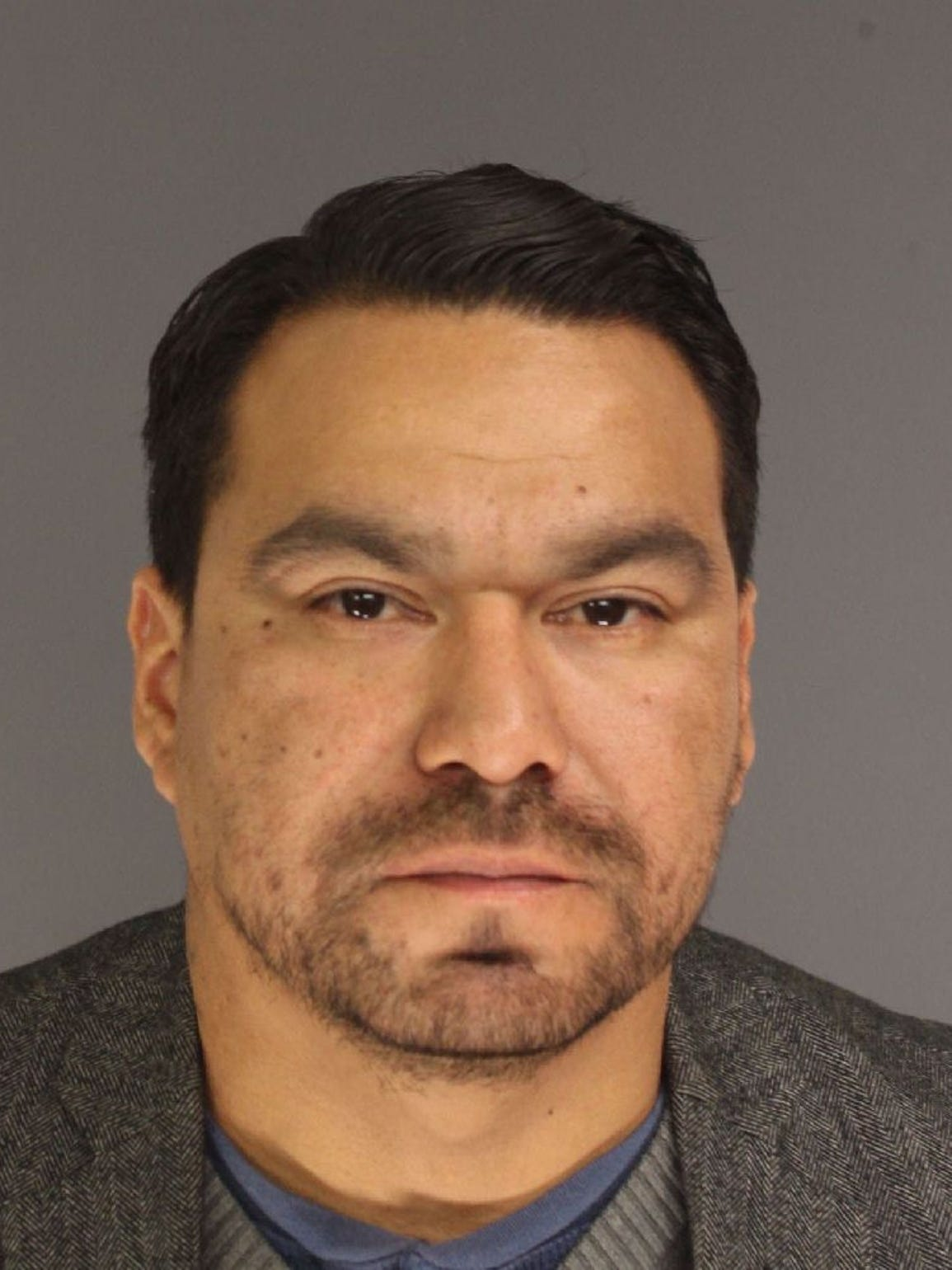 Former police officer Ricardo Arias-Vasquez was arrested and charged with criminal sexual contact and witness tampering.