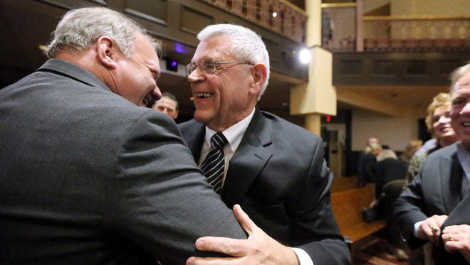 Deputy Chief Keith Lowery, left, congratulates Mike Fitzhugh as the Interim Rutherford County Sheriff after the Rutherford County Board of Commissioners voted Fitzhugh as Interim Rutherford County Sheriff, on Thursday, Jan. 12, 2017.