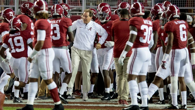 Alabama head coach Nick Saban with his team as they prepare to take the field for warm ups before the LSU game at Bryant Denny Stadium in Tuscaloosa, Ala. on Saturday November 4, 2017.