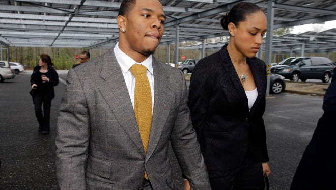 In this May 1, 2014, file photo, former Baltimore Ravens running back Ray Rice holds hands with his wife, Janay Palmer, as they arrive at Atlantic County Criminal Courthouse in Mays Landing, N.J.