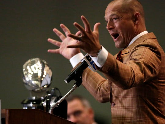 New Minnesota football coach P.J. Fleck speaks at Big Ten Conference media days Tuesday in Chicago, where his words flowed freely and quickly.