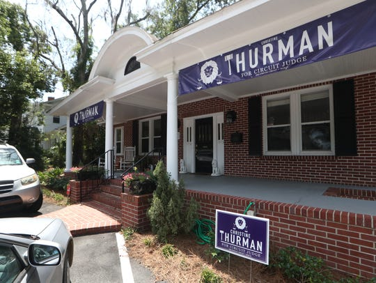 Campaign signs for judicial candidate Christine Thurman