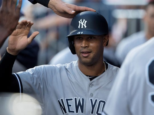 New York Yankees center fielder Aaron Hicks (31) celebrates in the dugout after scoring against the Philadelphia Phillies during the third inning at Citizens Bank Park.