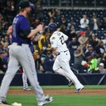 San Diego Padres' Matt Kemp rounds the bases as Colorado Rockies pitcher Eddie Butler watches in the fourth inning of a baseball game Tuesday, May 3, 2016, in San Diego. (AP Photo/Lenny Ignelzi)