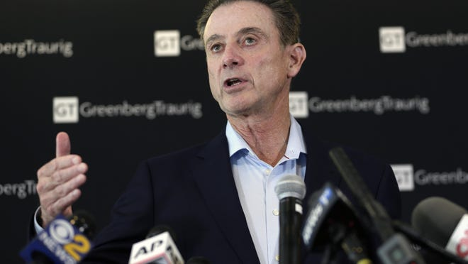 Rick Pitino appears during a news conference in New York, Feb. 21, 2018.