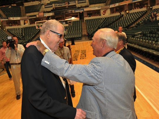 "Bobby ""Slick"" Leonard talks July 29, 2014, to Clyde Lovellette (left), who played basketball at Garfield High School in Terre Haute, after viewing the documentary ""Heart of a Hoosier"" at Bankers Life Fieldhouse."