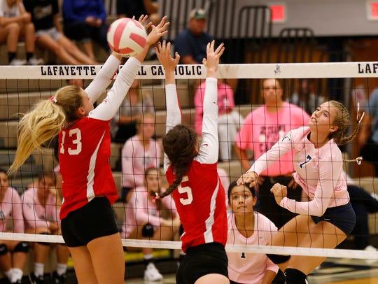 Kayla Brady of Central Catholic spikes the ball past