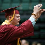 Dylan Leschak conducts the Rocky Mountain High School band before the start of the commencement ceremony on Saturday, May 21, 2016 at Moby Arena in Fort Collins.