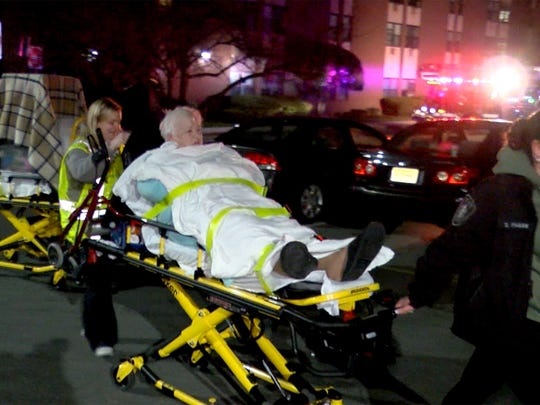 A woman is transported by first aiders after a fire
