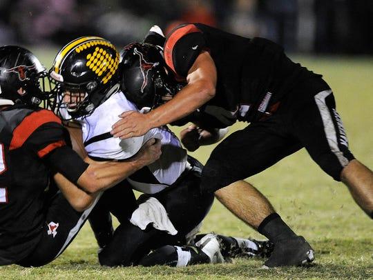 Cisco quarterback Kase Gayle (7) is tackled by Eastland