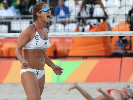Aug 11, 2016; Rio de Janeiro, Brazil; United States right defender Brooke Sweat (2) reacts after a point in a women's preliminary - Pool A match against Russia at the Beach Volleyball Arena during the Rio 2016 Summer Olympic Games. Mandatory Credit: Keven Jairaj-USA TODAY Sports