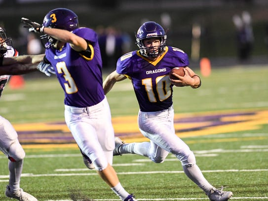Johnston Quarterback Andrew Nord (10) looks down field