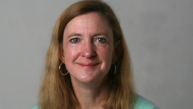 Investigative reporter Jennifer Dixon was named Journalist of the Year for her 2014 work.