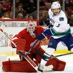 Jimmy Howard saves Red Wings again in 3-1 win over Canucks