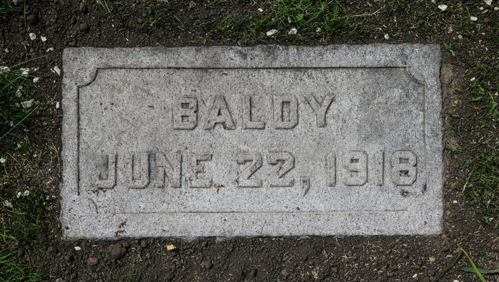 A grave marker reads 'Baldy' at Showman's Rest mass