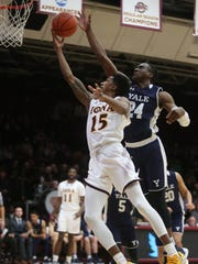 Yale's Miye Oni (24) guards Iona's Deyshonee Much (15) as he goes up for two during Men's basketball at the Hynes Center in New Rochelle Dec.12, 2017.