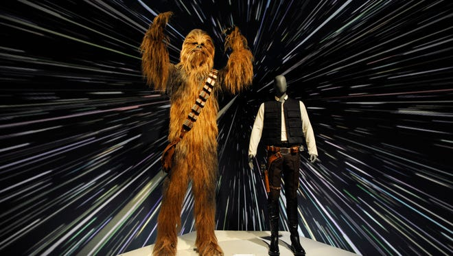 "The costumes for the characters of Chewbacca, left, and Han Solo are displayed May 17, 2018, at the Detroit Institute of Arts, which is preparing to open the traveling exhibit ""Star Wars and the Power of Costume."" The exhibit will run from May 20 to Sept. 30."