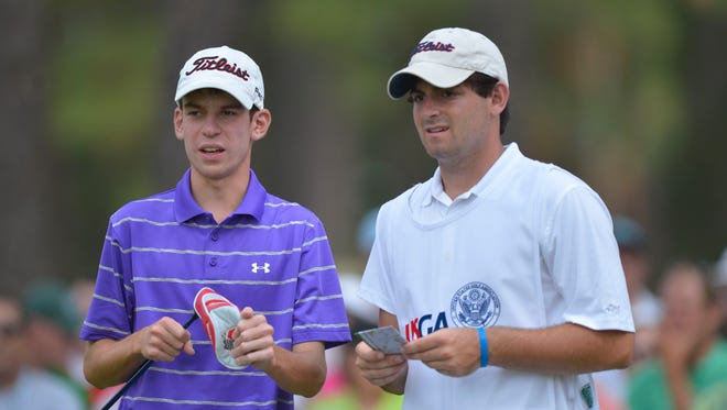 Will Grimmer (left) and caddie Michael Misleh (right) on the 17th tee during the first round of the 2014 U.S. Open golf tournament at Pinehurst Resort Country Club - #2 Course.