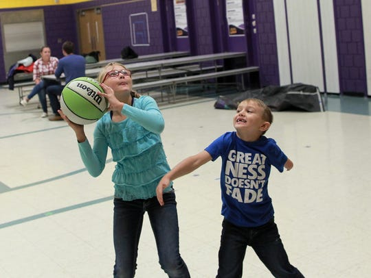 Jayce Crowder, 6, plays basketball with his sister