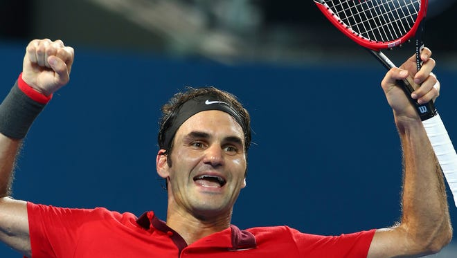Roger Federer of Switzerland reacts after he won the men's final match against Milos Raonic of Canada 6-4, 7-6, 6-7, 6-4 during the Brisbane International tennis tournament held in Brisbane, Australia, Sunday.