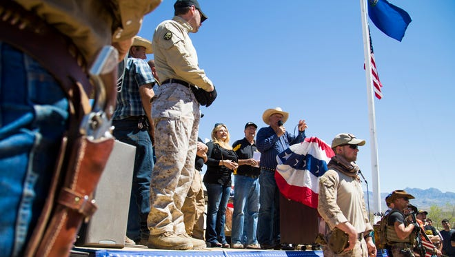 Cliven Bundy speaks to a crowd during a news conference in Bunkerville, Nevada, on April 14, 2014. The BLM seized about 400 head of cattle from the 68-year-old rancher over his refusal to pay an estimated $1 million in grazing fees over 20 years. They have since backed down and returned his cattle.