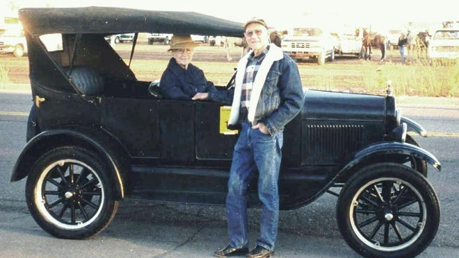 Albert Nichols and his wife, Geraldine, pose with their Model T before a Gilbert Days Parade.
