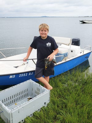 Adam Carpenter displays the catch of the day, a rare blue lobster.
