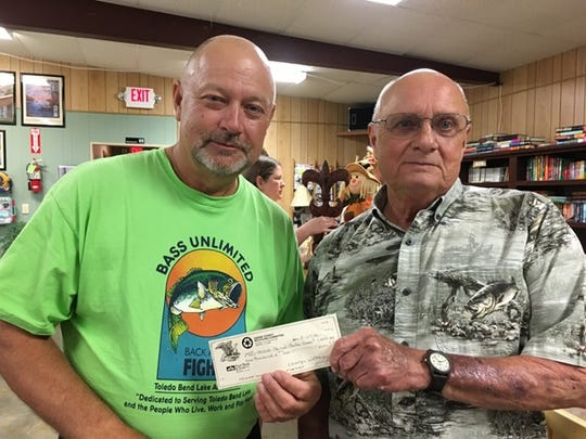 TBLA board member Gary Moore with Richard Knight, who recently donated $1,000 to the TBLA.