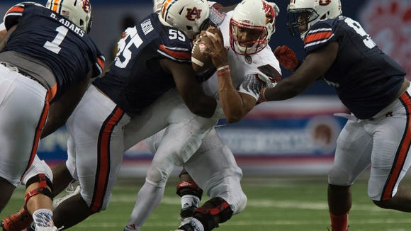 Auburn defensive lineman Carl Lawson (55) sacks Louisville quarterback Reggie Bonnafon (7) during the NCAA football game between Auburn and Louisville on Saturday, Sept. 5, 2015, in at the Georgia Dome in Atlanta, Ga.