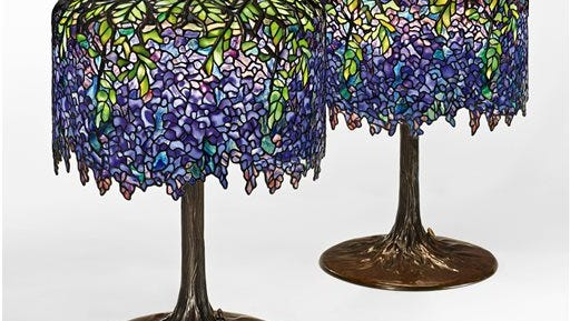 This undated photo provided by Sotheby's shows two nearly identical Tiffany wisteria lamps designed in 1901 that will be sold by Sotheby's on Dec. 17.  The lamps, which are among more than 30 other Tiffany lots in the auction, could sell for up to $1 million each at auction.