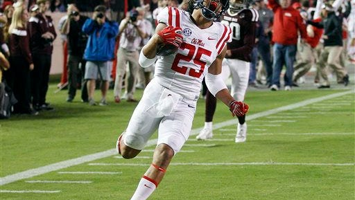 Ole Miss defensive back Cody Prewitt (25) returns an interception for a 75-yard touchdown against Texas A&M during the second quarter of an NCAA college football game Saturday, Oct. 11, 2014, in College Station, Texas. (AP Photo/Bob Levey)