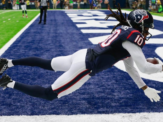 DeAndre Hopkins (10) of the Houston Texans scores a 27-yard receiving touchdown in the first quarter against the Kansas City Chiefs on Sunday in Houston.