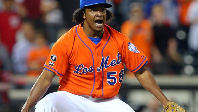 New York Mets relief pitcher Jenrry Mejia celebrates after defeating the Washington Nationals 4-3 at Citi Field.