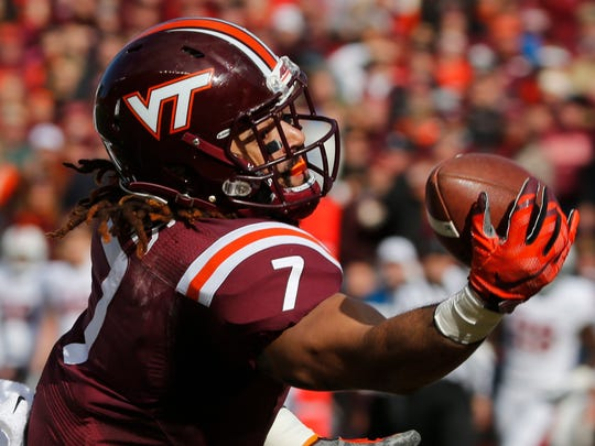 Virginia Tech tight end Bucky Hodges (7) reaches for