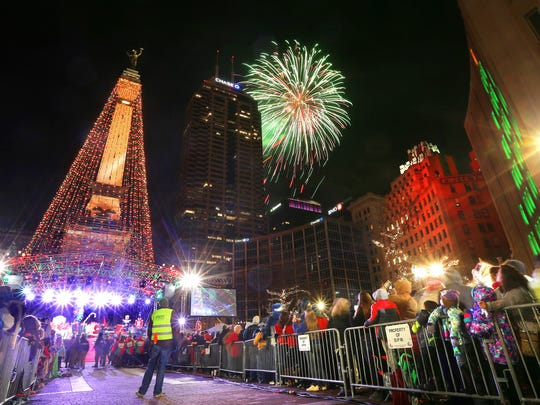 The Soldiers & Sailors Monument is lit up and fireworks fill the sky after the switch was flipped during the Downtown Indianapolis Circle of Lights in 2014.
