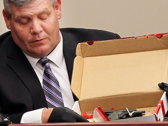 Highland Heights Police Lt. Dave Fornash holds an evidence box containing the Sig Sauer .380 pistol used to kill Ryan Poston. He was showing the gun to the jury during testimony at Shayna Hubers' murder trial. He was sergeant with the department and the first officer on the scene the night Poston was killed in 2012.