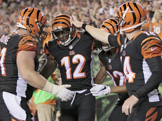 The Bengals celebrate wide receiver Mohamed Sanu's touchdown run in the fourth quarter on Thursday.