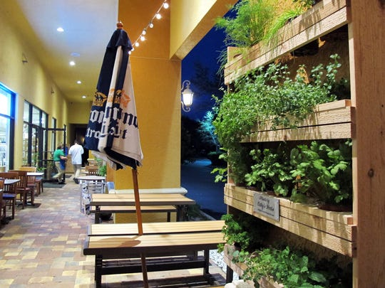 Fresh herbs line the patio at Charlie's Clams, Crabs & Seafood in North Naples.