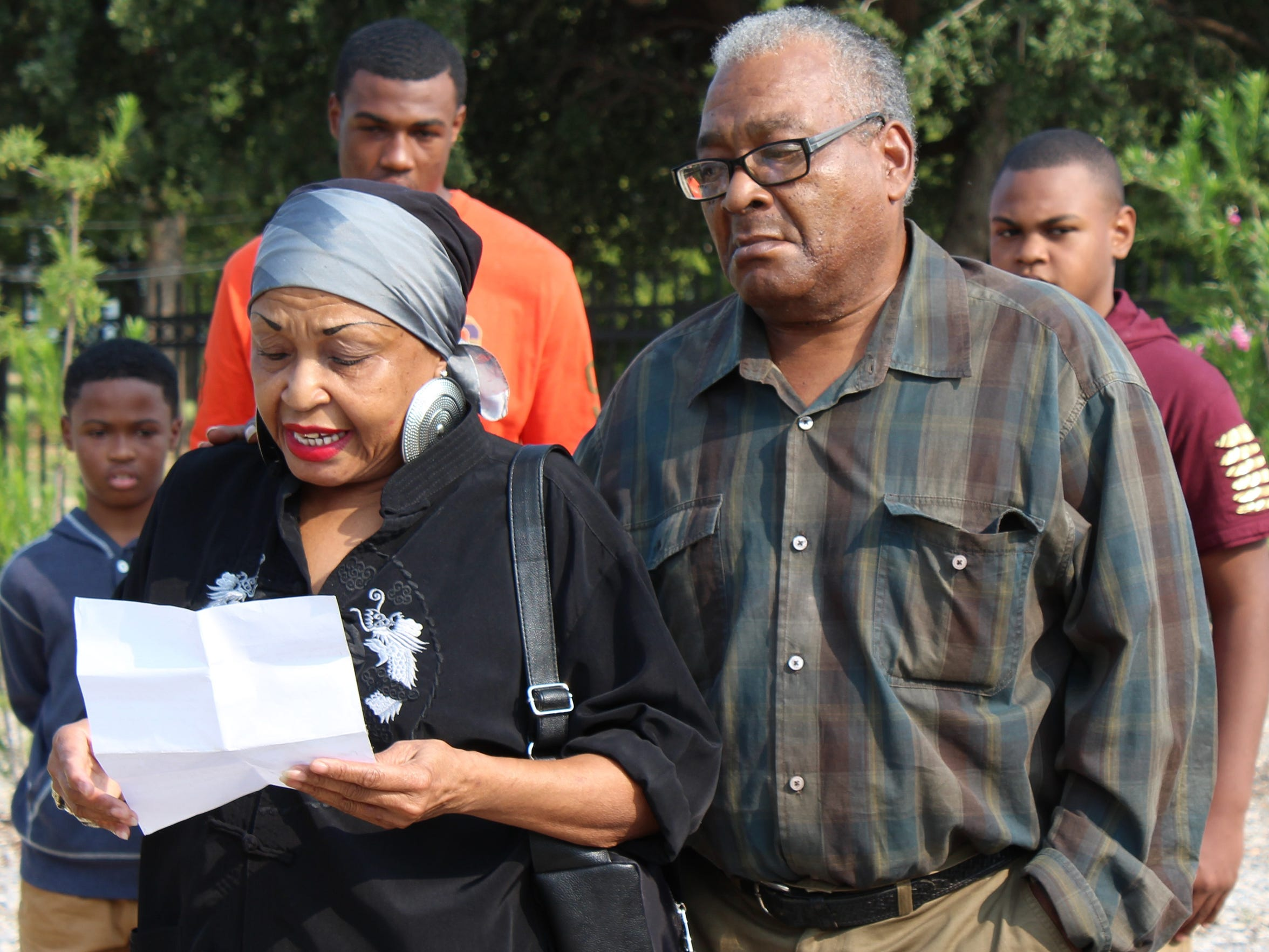 Mary Dansby, left, reads a poem about the life her mother, Idella James, at Wednesday's marker dedication. Brother Robert James stands beside her.