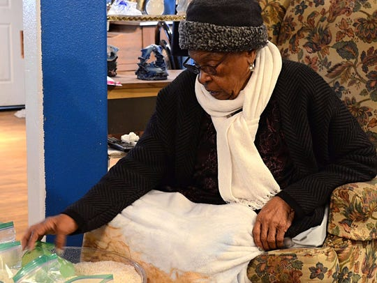 Evelyn Mount, 92, helps re-package uncooked rice into