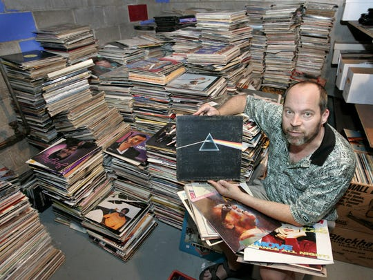 Rick Wilkerson poses with records in 2008.